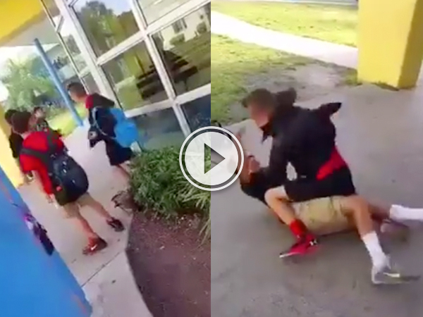 A bully in black shorts and jacket hits another kid with Nike shoes who is sprawled on the ground!
