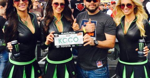 Sexy 'Monster Energy' in deep neck faux leather tight tees and mini skirts pose with a man holding a KCCO sign!