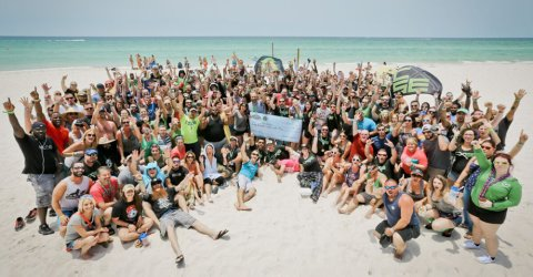 Beautiful group of youthful people partying in the beach.