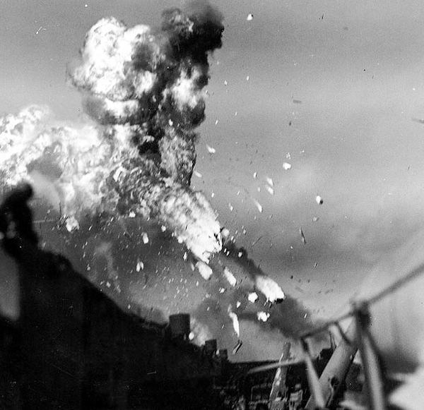 Huge flames and scattering of debris onboard the USS Missouri during the kamikaze attack