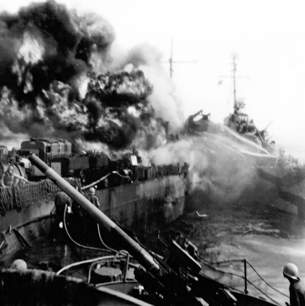 USS Missouri's deck going up in flames and wreck after Kamikaze attack.