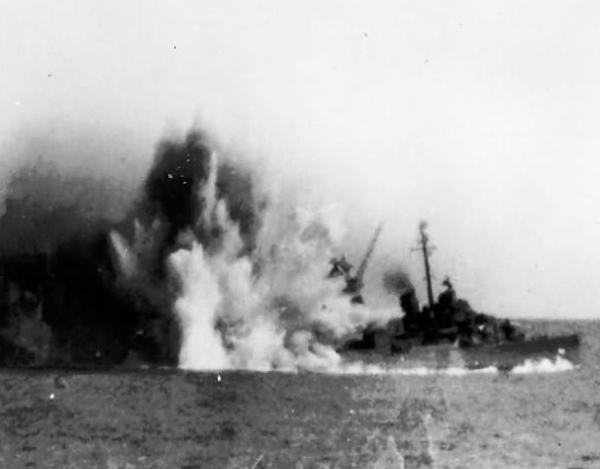 USS Missouri sinking slowly with a huge splash