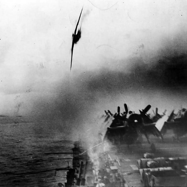 A black and white photograph of two fighter planes storming the USS Missouri