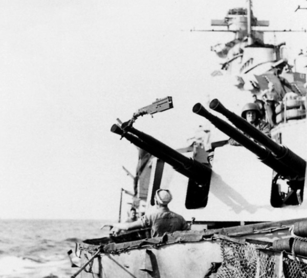 Sailor and soldiers near the AA guns watching the skies for enemy aircrafts