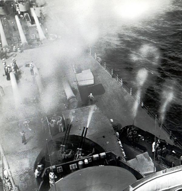 AA guns onboard a battleship firing at a target