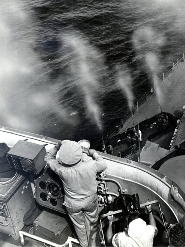 Sailors spotting the inbound targets onboard, while the AA guns are being fired.