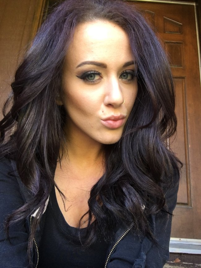 Gorgeous light-eyed brunette with juicy lips takes selfie in black top and jacket