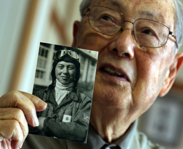 A veteran soldier shows his photograph when he was a pilot of WW2