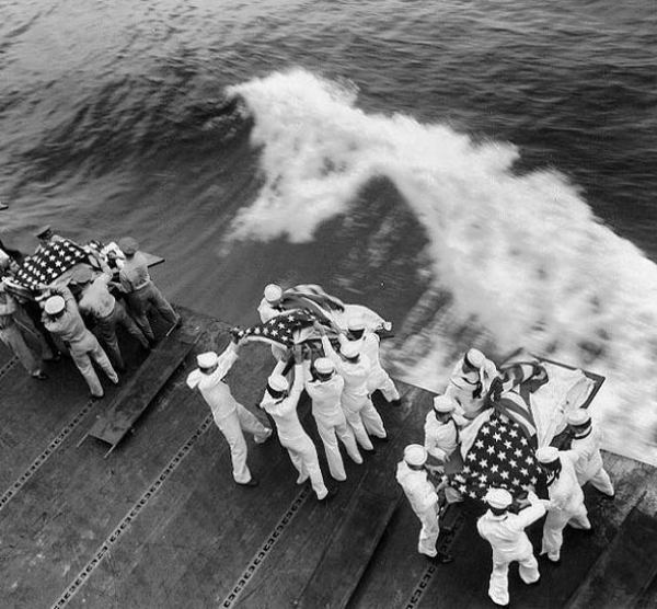 Sailors of USS Missouri wrapping the dead in National Flag and performing burial
