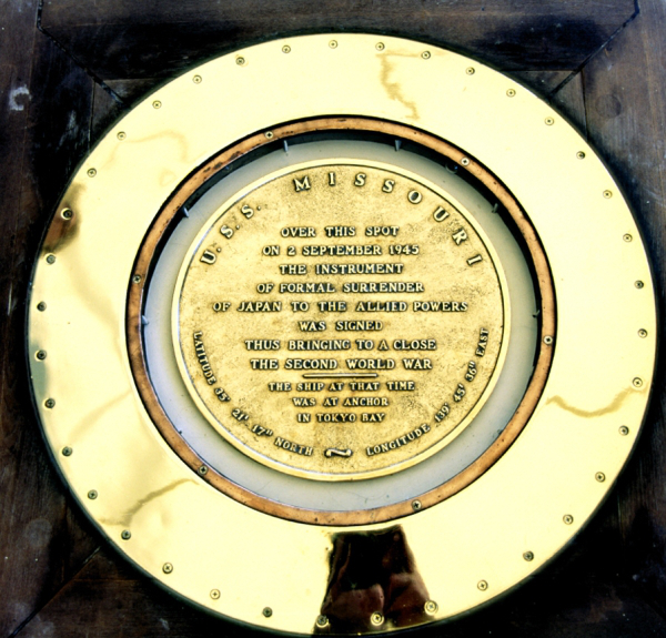 A memorial structure onnboard USS Missouri stating the events of Sept.2, 1945