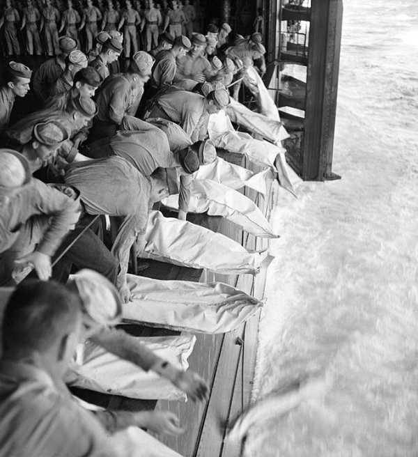 Sailors onboard USS Missouri performing the burial of the dead of Kamikaze attack.