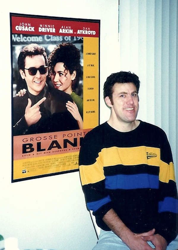 Posing in front of movie poster jubilant.