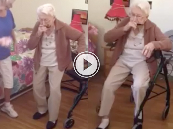 Old grandma playing a mouth organ
