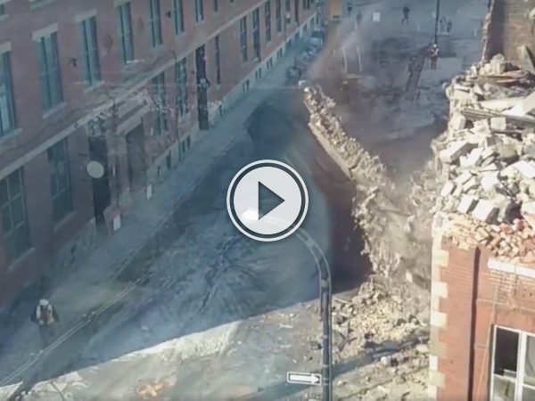 Dude narrowly avoids getting caught under a crumbling wall (Video)