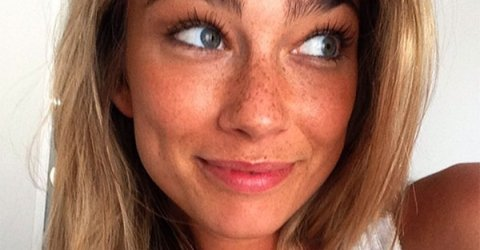 Green eyed freckled girl smiles for th selfie