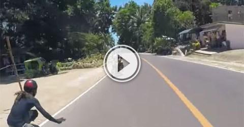 Longboarder just misses motorcyclist (Video)