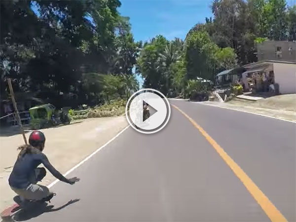 Longboarder just misses motorcyclist (Video)