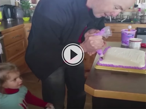 Video of dad preparing a cake.
