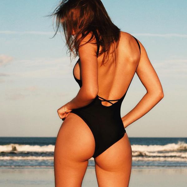 Sexy Elizabeth Zaks shows off her perfect ass in a black swimwear.