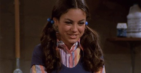 """Cute American actress Jackie Burkhart leads a cherleader role as a Mila"""" Kunis in That 70s Show"""