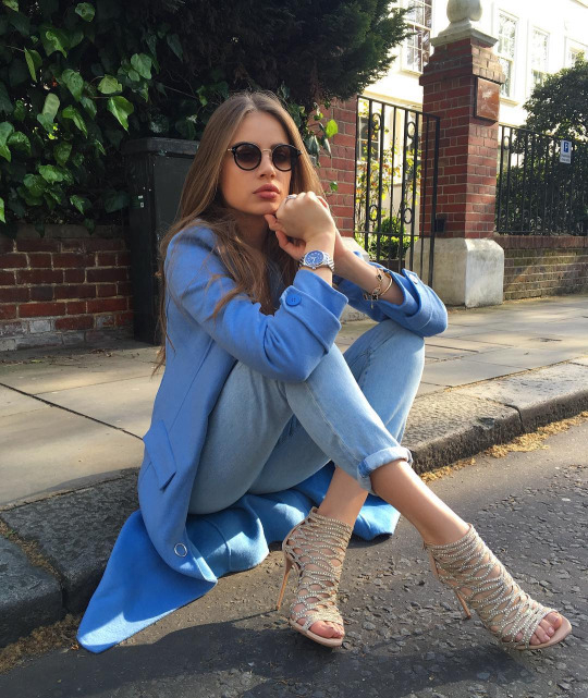 Vintage sunglasses with denims and long jacket and gladiator heels