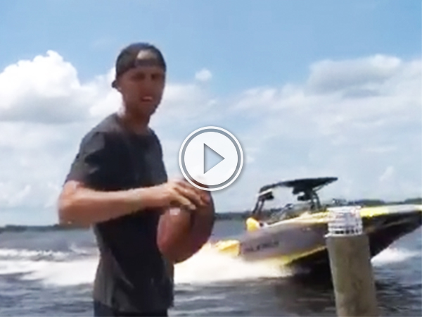 Wakeboarder splendidly catches a football mid backflip (video grab)