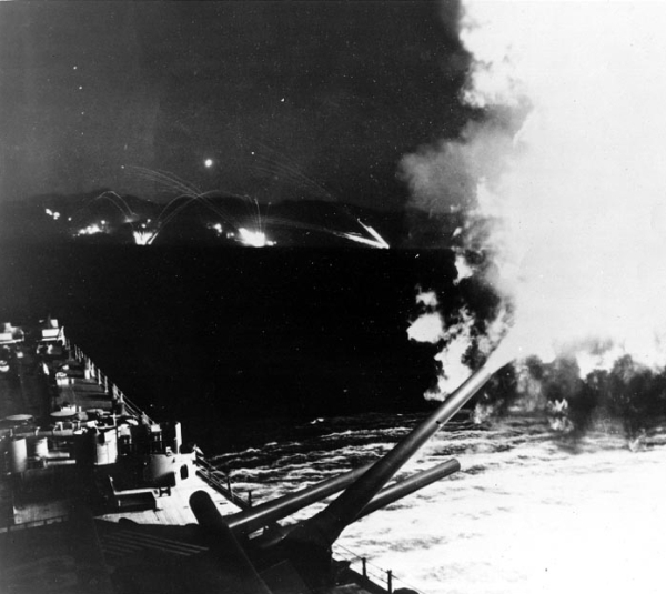 A battleship in action with guns firing at targets!