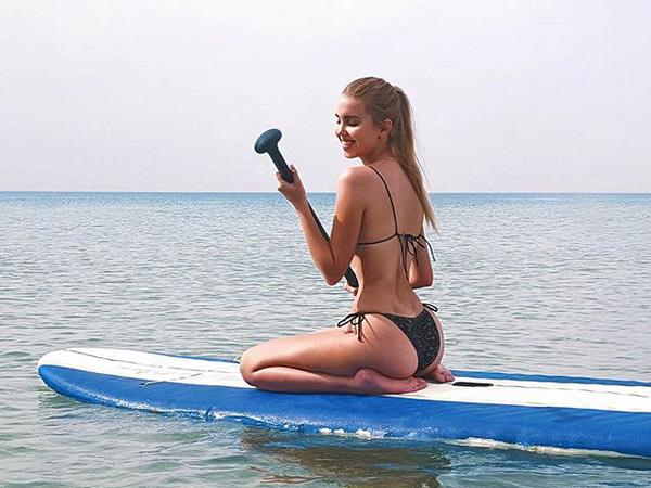 Sexy chick in bikini sailing in the sea