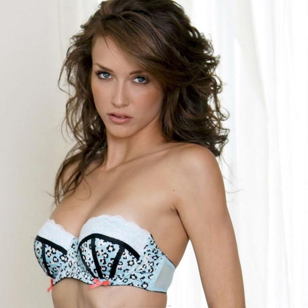 Hot chick in off shoulder designer lingerie posing for the camera
