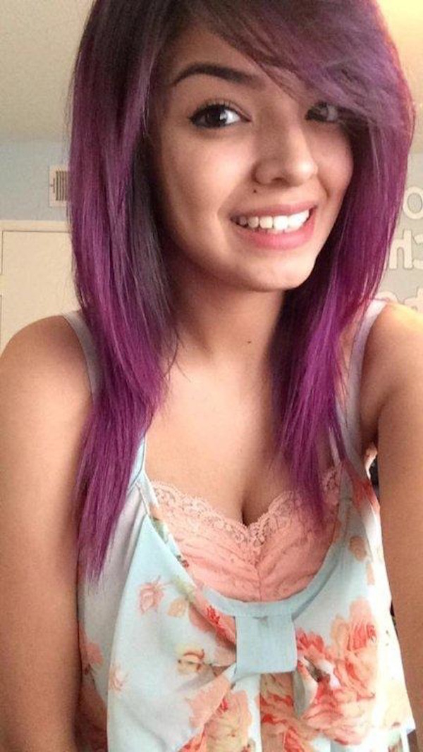 Girl with violet dyed hair takes selfie in white/red lace top