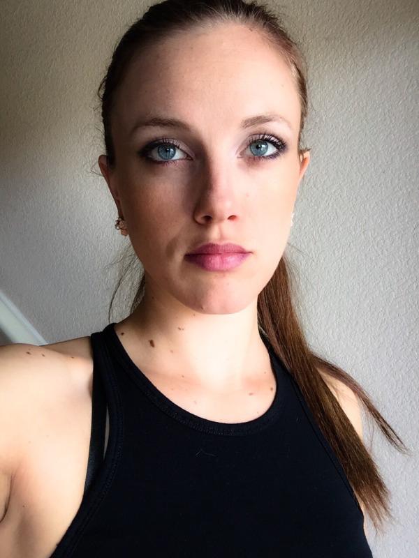 Cute blonde with grey eyes and full lips takes selfie in black top