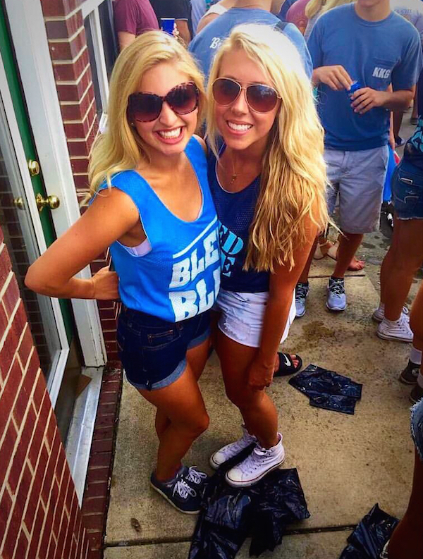 Cute blondes smile for camera in blue tops and blue and white denim shorts