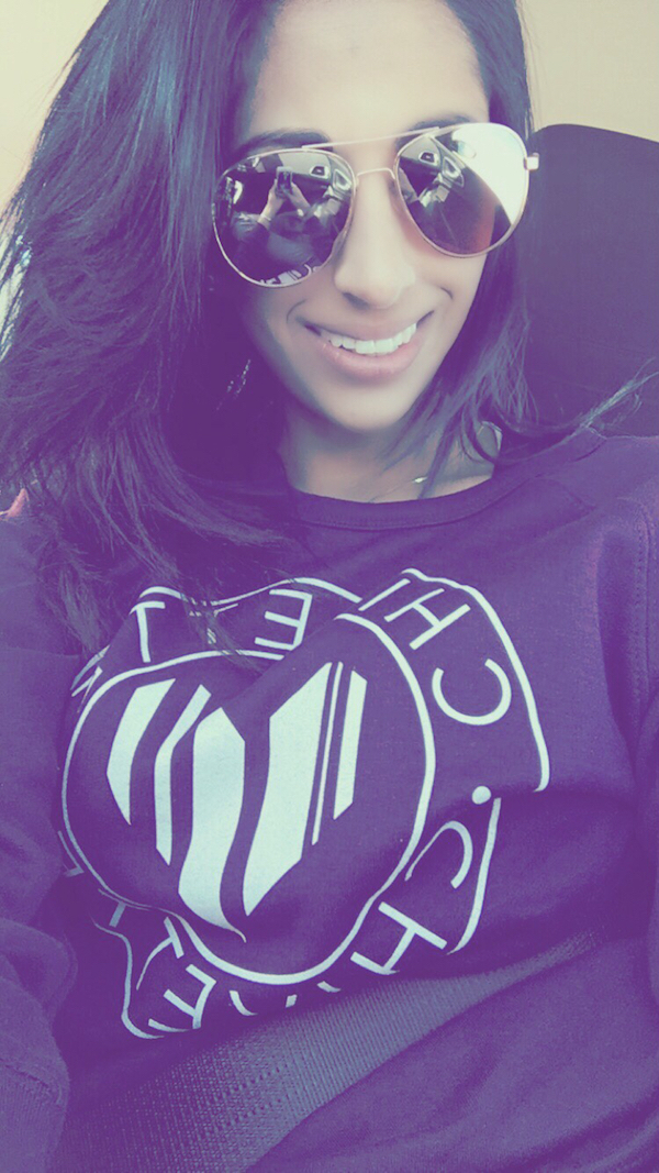 Gorgeous mature girl looking very happy in CHIVETTE logo t-shirt and sexy brown aviator sunglasses