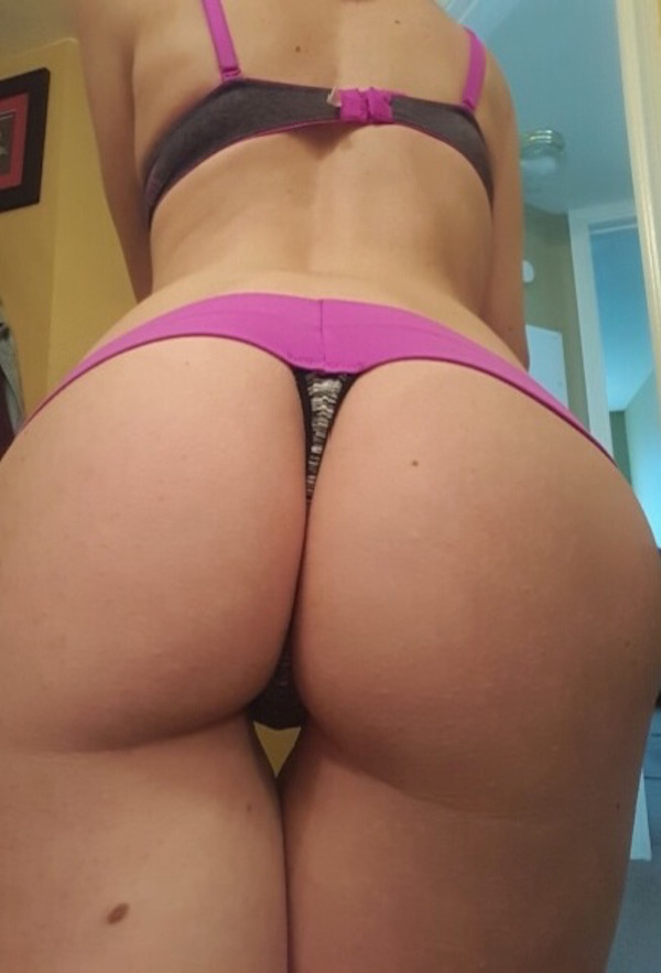 Girl flaunts sexy curves and ample butt cheeks in black/magenta bra and panties
