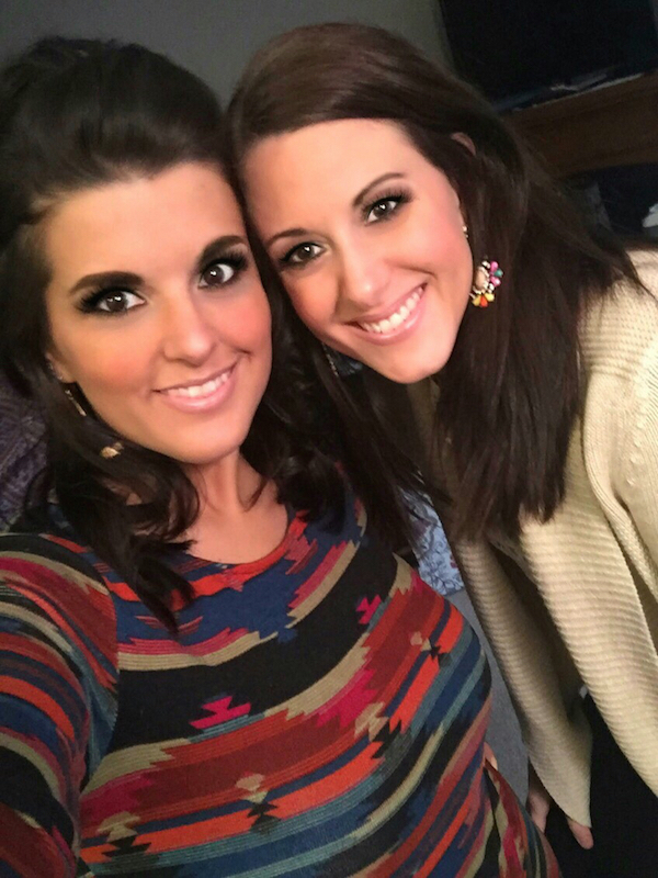Gorgeous light-eyed brunettes smile for selfie in blue/red/black and white tops