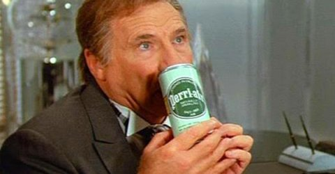 A scene from movie spaceballs where President Skroob breathes in air from a can!