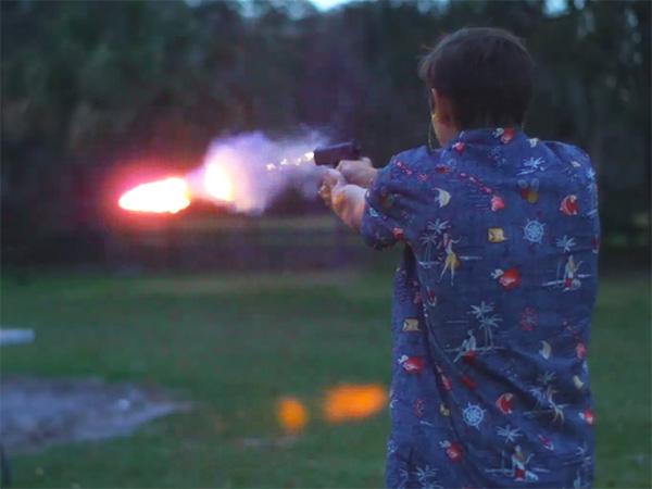 Man shooting out a fire bullet from a gun