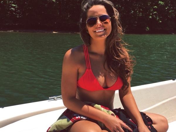 Pretty woman wearing three strap red bikini top, cool goggles, has sexy saggy boobs