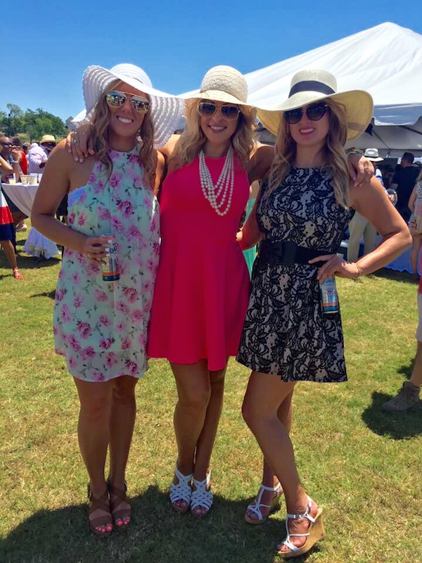 Voluptuous women with sexy legs pose for camera in sunglasses, beige hats, and pink, white, and black short dresses