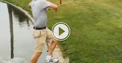 A man playing golf - tricky golf shot makes a splash