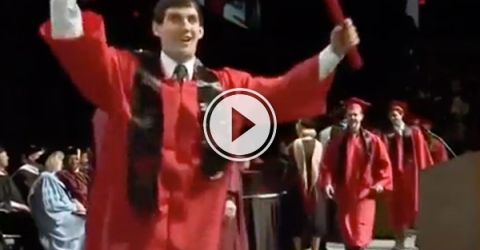 Dude in red graduation gown exults after getting the degree!