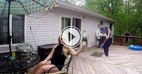 Video grab of a guy popping champagne with a golf ball