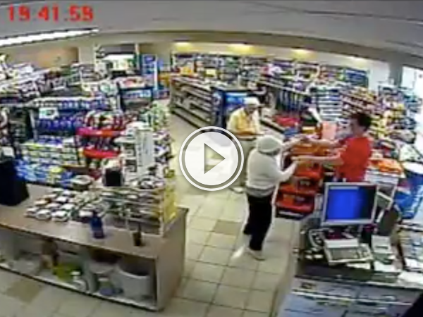 Guy slow dances with an elderly lady in a gas station (Video)