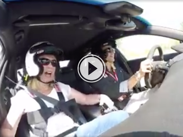 Screenshot of the video of a Reactions of a woman inside a racing car