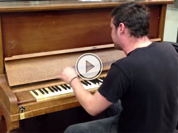 Video grab of a man playing a piano