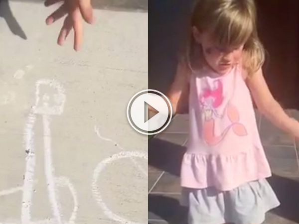 A chalk drawing on concrete and a little girl in grey skirt and pink top!
