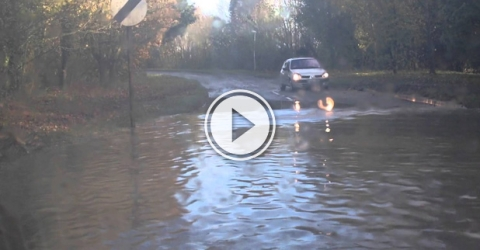 Funny video of a car getting stuck in a deep road filled with water.