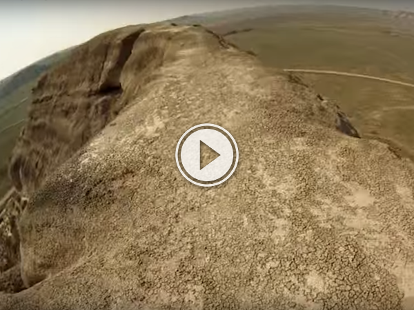 Sask. daredevil rides a unicycle across a metre high ridge, for fun! (Video)