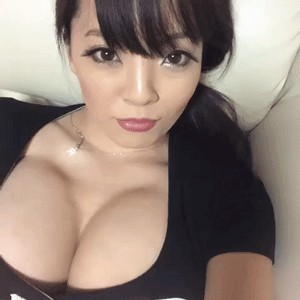 Busty blonde with fringe hair cut bouncing her large juicy boobs. gif