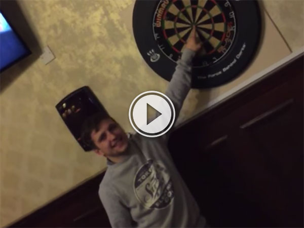 Man puts his fingers on the line in darts challenge (Video)